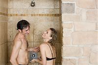 Couple showering together Stock Photo - Premium Royalty-Freenull, Code: 6114-06646224