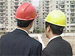Men in hard hats Stock Photo - Premium Royalty-Free, Artist: Westend61, Code: 6114-06646391