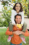 Father shoulder carrying daughter Stock Photo - Premium Royalty-Free, Artist: Norbert Schäfer, Code: 6114-06646631