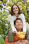 Father shoulder carrying daughter Stock Photo - Premium Royalty-Free, Artist: Photocuisine, Code: 6114-06646645