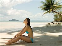 paradise (place of bliss) - Woman sitting on beach Stock Photo - Premium Royalty-Freenull, Code: 6114-06646824