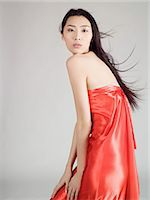 silky - Chinese woman wearing a red silk dress Stock Photo - Premium Royalty-Freenull, Code: 6114-06646875