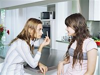 Girl and mother with cigarette Stock Photo - Premium Royalty-Freenull, Code: 6114-06647221