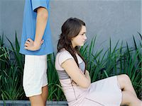 Boy and girl looking moody Stock Photo - Premium Royalty-Freenull, Code: 6114-06647233