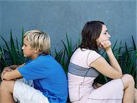 Brother and sister back to back Stock Photo - Premium Royalty-Freenull, Code: 6114-06647245