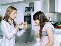 Girl and mother with cigarette Stock Photo - Premium Royalty-Freenull, Code: 6114-06647250