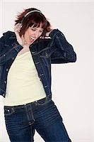 Woman listening to music Stock Photo - Premium Royalty-Freenull, Code: 6114-06647409