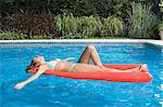 Woman relaxing in swimming pool Stock Photo - Premium Royalty-Free, Artist: Westend61, Code: 6114-06647559
