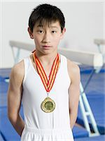 Boy wearing a medal Stock Photo - Premium Royalty-Freenull, Code: 6114-06647690