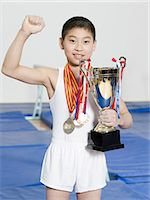 Boy with medals and trophy Stock Photo - Premium Royalty-Freenull, Code: 6114-06647693