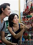 Couple looking at souvenirs Stock Photo - Premium Royalty-Free, Artist: Robert Harding Images    , Code: 6114-06647705