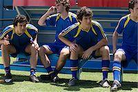 footballeur - Footballer using cell phone Stock Photo - Premium Royalty-Freenull, Code: 6114-06647780