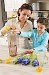 Woman and daughter with flowers Stock Photo - Premium Royalty-Free, Artist: Robert Harding Images, Code: 6114-06647861