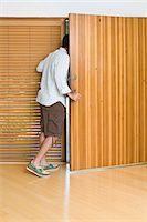 Man opening front door Stock Photo - Premium Royalty-Freenull, Code: 6114-06648131