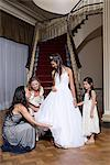 Girl and relations preparing for quinceanera Stock Photo - Premium Royalty-Free, Artist: Masterfile, Code: 6114-06648147