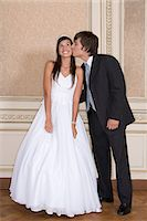 Boy kissing girl at quinceanera Stock Photo - Premium Royalty-Freenull, Code: 6114-06648148