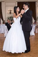 Girl and father dancing at quinceanera Stock Photo - Premium Royalty-Freenull, Code: 6114-06648193