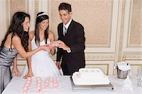 Lighting candles for quinceanera Stock Photo - Premium Royalty-Freenull, Code: 6114-06648203