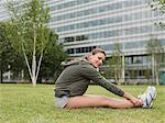A woman stretching Stock Photo - Premium Royalty-Freenull, Code: 6114-06649576
