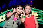 Teenage girls with earphones Stock Photo - Premium Royalty-Free, Artist: AWL Images, Code: 6114-06649629