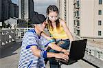 Teenage couple using laptop outdoors Stock Photo - Premium Royalty-Free, Artist: Cultura RM, Code: 6114-06649658