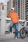 Young man with bike and cellphone Stock Photo - Premium Royalty-Free, Artist: Robert Harding Images, Code: 6114-06649670