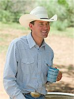 Cowboy with coffee cup Stock Photo - Premium Royalty-Freenull, Code: 6114-06649775