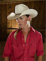 Portrait of a cowgirl Stock Photo - Premium Royalty-Freenull, Code: 6114-06649788