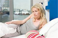 Woman in bed Stock Photo - Premium Royalty-Freenull, Code: 6114-06650220