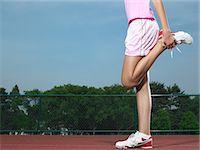 preteen girl feet - A girl stretching Stock Photo - Premium Royalty-Freenull, Code: 6114-06650252