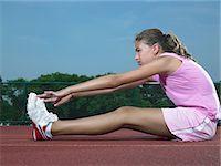 preteen girl feet - A girl stretching Stock Photo - Premium Royalty-Freenull, Code: 6114-06650300