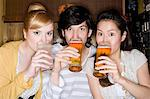 Portrait of friends drinking beer Stock Photo - Premium Royalty-Free, Artist: Cusp and Flirt, Code: 6114-06650413