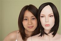 Woman and a mannequins faces Stock Photo - Premium Royalty-Freenull, Code: 6114-06650520