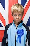 Boy wearing a rosette Stock Photo - Premium Royalty-Free, Artist: Photocuisine, Code: 6114-06650568