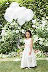 Flower girl with balloons Stock Photo - Premium Royalty-Free, Artist: Blend Images, Code: 6114-06650845