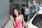 Woman in car dealership Stock Photo - Premium Royalty-Free, Artist: Blend Images, Code: 6114-06650951