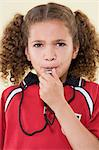 Girl blowing whistle Stock Photo - Premium Royalty-Freenull, Code: 6114-06651109
