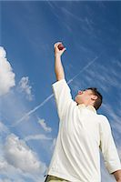 A cricket player catching a cricket ball Stock Photo - Premium Royalty-Freenull, Code: 6114-06651951