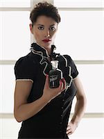 poison - Woman holding a bottle of poison Stock Photo - Premium Royalty-Freenull, Code: 6114-06652009