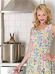 Woman cooking a rabbit Stock Photo - Premium Royalty-Free, Artist: CulturaRM, Code: 6114-06652031