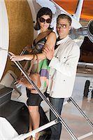 Glamorous couple boarding jet Stock Photo - Premium Royalty-Freenull, Code: 6114-06652221