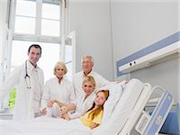 Doctors with a patient Stock Photo - Premium Royalty-Freenull, Code: 6114-06652391