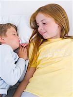 Sister looking at brother sleeping Stock Photo - Premium Royalty-Freenull, Code: 6114-06652431