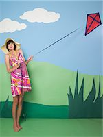 Young woman with kite Stock Photo - Premium Royalty-Freenull, Code: 6114-06652601