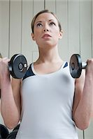 A woman weightlifting Stock Photo - Premium Royalty-Freenull, Code: 6114-06652842