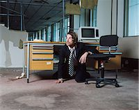 people in panic - Businessman emerging from under desk Stock Photo - Premium Royalty-Freenull, Code: 6114-06654167