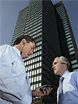 Two businessmen outside building Stock Photo - Premium Royalty-Free, Artist: Robert Harding Images, Code: 6114-06654229
