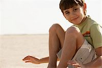 Boy on the beach Stock Photo - Premium Royalty-Freenull, Code: 6114-06654637