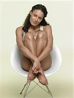 Woman sat in chair Stock Photo - Premium Royalty-Freenull, Code: 6114-06655318