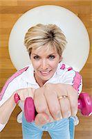 fitness older women gym - Woman using dumbbells Stock Photo - Premium Royalty-Freenull, Code: 6114-06655563